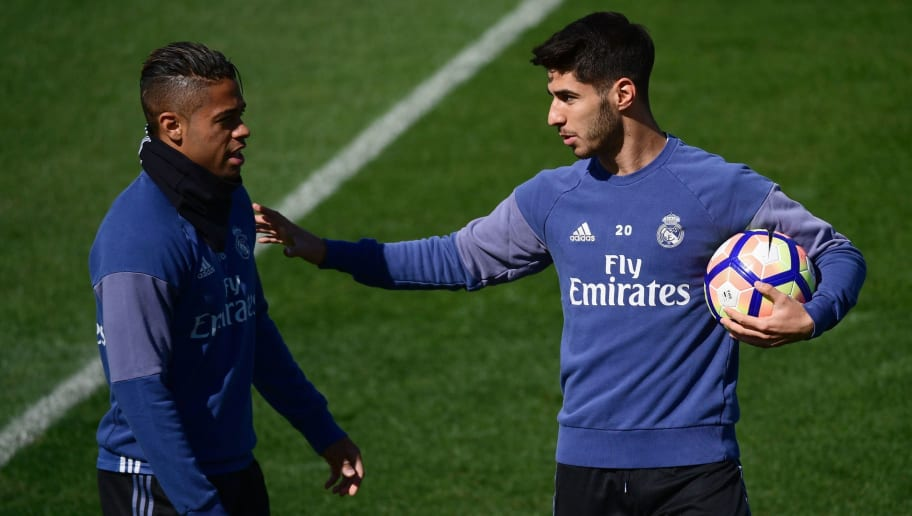 Real Madrid's midfielder Marco Asensio (R) and Real Madrid's forward Mariano Diaz attend a training session at Valdebebas Sport City in Madrid on April 28, 2017 on the eve of their Liga football match against Valencia. / AFP PHOTO / PIERRE-PHILIPPE MARCOU        (Photo credit should read PIERRE-PHILIPPE MARCOU/AFP/Getty Images)