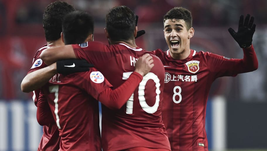 SHANGHAI, CHINA - FEBRUARY 28: Wu Lei #7 of Shanghai SIPG celebrates with team mates after scoring his team's fifth goal during the AFC Champions League 2017 Group F match between Shanghai SIPG and Western Sydney Wanderers at Shanghai Stadium on February 28, 2017 in Shanghai, China.  (Photo by Visual China/Getty Images)