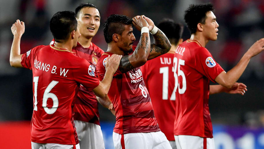 Bezerra Maciel Junior (C) of China's Guangzhou Evergrande celebrates after scroing a goal during the AFC Champions League round of 16 football match against Japan's Kashima Antlers  in Guangzhou, in China's Guangdong province on May 23, 2017. / AFP PHOTO / STR / CHINA OUT        (Photo credit should read STR/AFP/Getty Images)