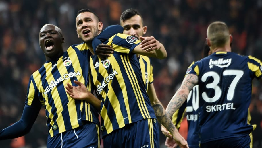 TOPSHOT - Fenerbahce's Brazilian midfielder Josef de Souza (C) celebrates after scoring a goal during the Turkish Super Lig football match between Galatasaray and Fenerbahce at theTT Arena stadium in Istanbul on April 23, 2017.  / AFP PHOTO / OZAN KOSE        (Photo credit should read OZAN KOSE/AFP/Getty Images)