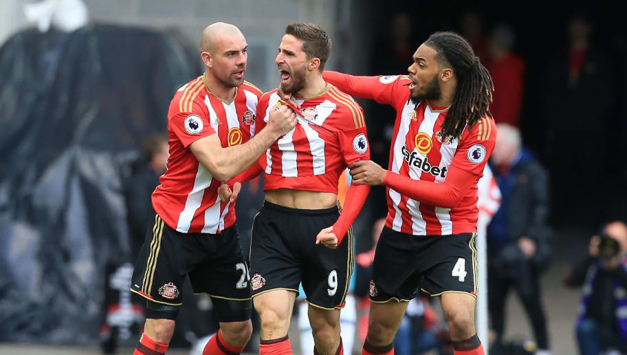 Sunderland's Italian striker Fabio Borini (C) celebrates scoring their second goal with Sunderland's Irish midfielder Darron Gibson (L) and Sunderland's Dutch defender Jason Denayer during the English Premier League football match between Sunderland and West Ham United at the Stadium of Light in Sunderland, north-east England on April 15, 2017. / AFP PHOTO / Lindsey PARNABY / RESTRICTED TO EDITORIAL USE. No use with unauthorized audio, video, data, fixture lists, club/league logos or 'live' services. Online in-match use limited to 75 images, no video emulation. No use in betting, games or single club/league/player publications.  /         (Photo credit should read LINDSEY PARNABY/AFP/Getty Images)