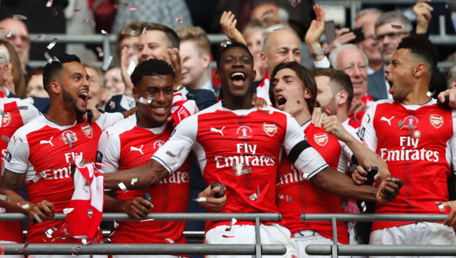 Arsenal's English striker Danny Welbeck (C) and Arsenal players celebrate their victory over Chelsea in the English FA Cup final football match between Arsenal and Chelsea at Wembley stadium in London on May 27, 2017. Aaron Ramsey scored a 79th-minute header to earn Arsenal a stunning 2-1 win over Double-chasing Chelsea on Saturday and deliver embattled manager Arsene Wenger a record seventh FA Cup. / AFP PHOTO / Adrian DENNIS / NOT FOR MARKETING OR ADVERTISING USE / RESTRICTED TO EDITORIAL USE        (Photo credit should read ADRIAN DENNIS/AFP/Getty Images)