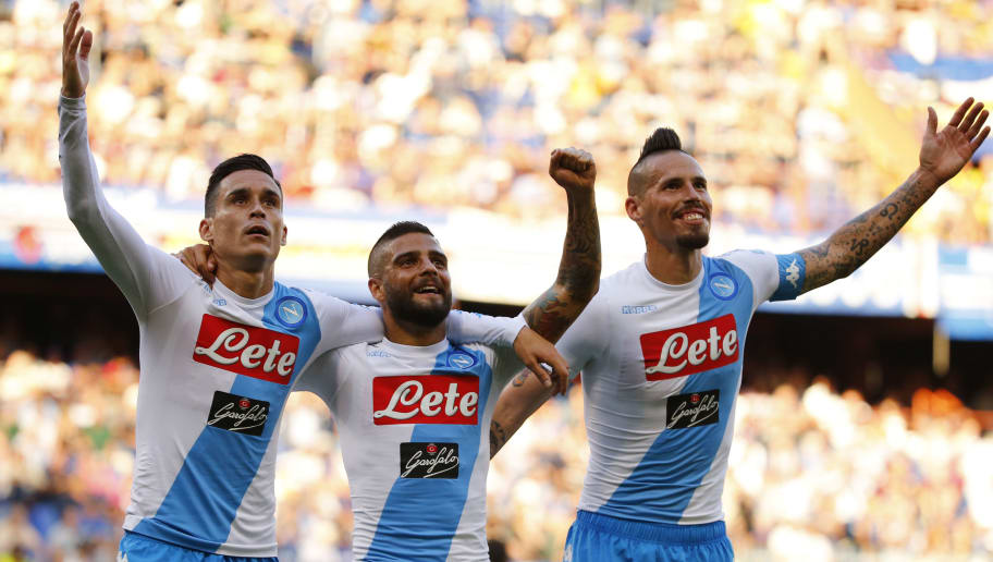 Napoli's forward Jose Maria Callejon from Spain (L) celebrates with teammates Napoli's forward Lorenzo Insigne (C) and Napoli's midfielder Marek Hamsik from Slovakia after scoring during the Italian Serie A football match Sampdoria Vs Napoli on May 28, 2017 at the 'Luigi Ferraris' in Genoa.  / AFP PHOTO / Marco BERTORELLO        (Photo credit should read MARCO BERTORELLO/AFP/Getty Images)