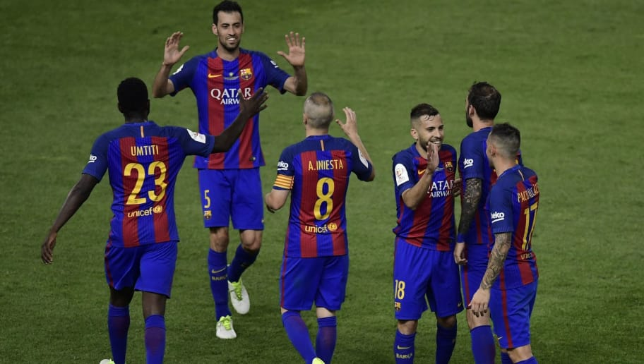 Barcelona players celebrate after winning the Spanish Copa del Rey (King's Cup) final football match FC Barcelona vs Deportivo Alaves at the Vicente Calderon stadium in Madrid on May 27, 2017. / AFP PHOTO / JAVIER SORIANO        (Photo credit should read JAVIER SORIANO/AFP/Getty Images)