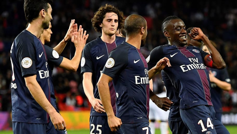 Paris Saint-Germain's French midfielder Blaise Matuidi (R) celebrates with his teammates after scoring a goal during the French L1 football match between Paris Saint-Germain and Guingamp at the Parc des Princes stadium, in Paris, on April 9, 2017. / AFP PHOTO / FRANCK FIFE        (Photo credit should read FRANCK FIFE/AFP/Getty Images)