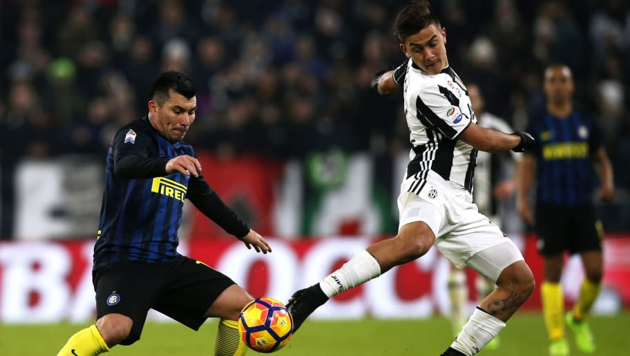 Inter Milan's Colombian defender Jeison Murillo (L) vies for the ball with Juventus' Argentinian forward Paulo Dybala during the Italian Serie A football match between Juventus and Inter Milan on February 5, 2017 at the Juventus Stadium in Turin.  / AFP / Marco BERTORELLO        (Photo credit should read MARCO BERTORELLO/AFP/Getty Images)