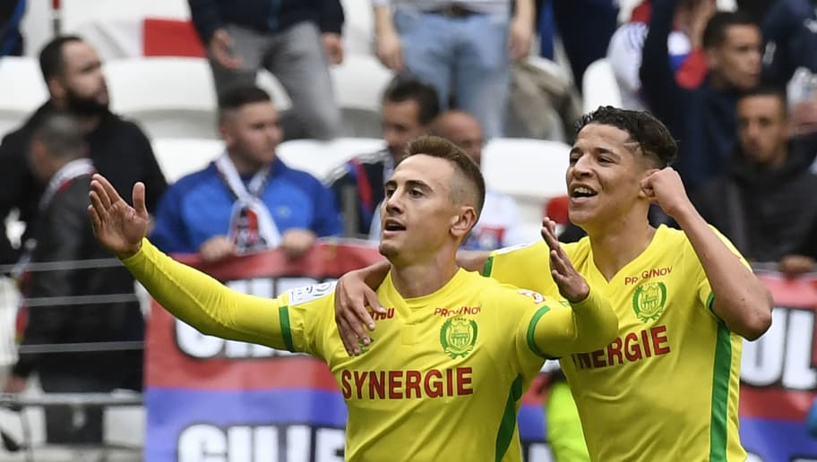 Nantes' French midfielder Valentin Rongier (L) celebrates with Nantes' French midfielder Amine Harit (R) during the French L1 football match between Lyon and Nantes at the Parc Olympique Lyonnais stadium in Decines-Charpieu near Lyon, southeastern France, on May 7, 2017. / AFP PHOTO / PHILIPPE DESMAZES        (Photo credit should read PHILIPPE DESMAZES/AFP/Getty Images)