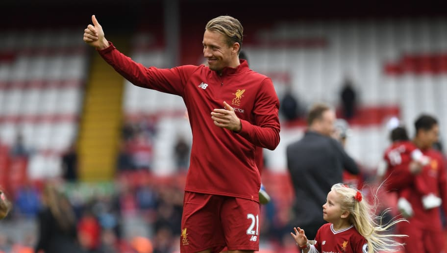 Liverpool's Brazilian midfielder Lucas Leiva applauds the fans following the English Premier League football match between Liverpool and Middlesbrough at Anfield in Liverpool, north west England on May 21, 2017. Liverpool won the match 3-0. / AFP PHOTO / Paul ELLIS / RESTRICTED TO EDITORIAL USE. No use with unauthorized audio, video, data, fixture lists, club/league logos or 'live' services. Online in-match use limited to 75 images, no video emulation. No use in betting, games or single club/league/player publications.  /         (Photo credit should read PAUL ELLIS/AFP/Getty Images)