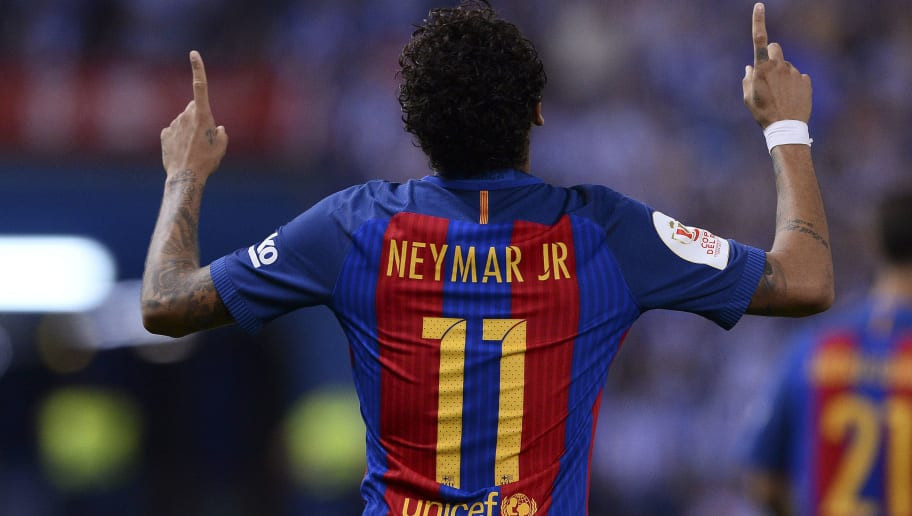 Barcelona's Brazilian forward Neymar celebrates after scoring during the Spanish Copa del Rey (King's Cup) final football match FC Barcelona vs Deportivo Alaves at the Vicente Calderon stadium in Madrid on May 27, 2017. / AFP PHOTO / Josep LAGO        (Photo credit should read JOSEP LAGO/AFP/Getty Images)