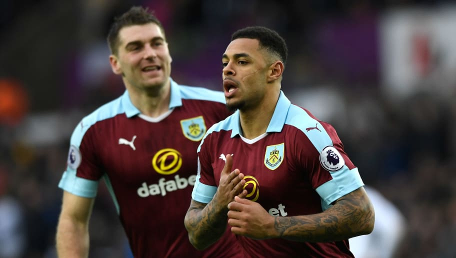 SWANSEA, WALES - MARCH 04: Andre Gray of Burnley celebrates scoring his sides first goal during the Premier League match between Swansea City and Burnley at Liberty Stadium on March 4, 2017 in Swansea, Wales.  (Photo by Stu Forster/Getty Images)