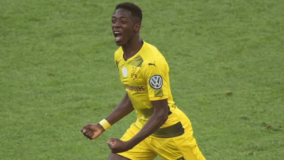 Dortmund's French midfielder Ousmane Dembele celebrates scoring the opening goal during the German Cup (DFB Pokal) final football match Eintracht Frankfurt v BVB Borussia Dortmund at the Olympic stadium in Berlin on May 27, 2017. / AFP PHOTO / Odd ANDERSEN / RESTRICTIONS: ACCORDING TO DFB RULES IMAGE SEQUENCES TO SIMULATE VIDEO IS NOT ALLOWED DURING MATCH TIME. MOBILE (MMS) USE IS NOT ALLOWED DURING AND FOR FURTHER TWO HOURS AFTER THE MATCH. == RESTRICTED TO EDITORIAL USE == FOR MORE INFORMATION CONTACT DFB DIRECTLY AT +49 69 67880   /         (Photo credit should read ODD ANDERSEN/AFP/Getty Images)