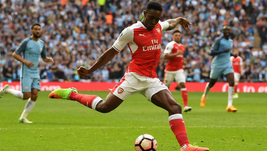 Arsenal's English striker Danny Welbeck shoots during the FA Cup semi-final football match between Arsenal and Manchester City at Wembley stadium in London on April 23, 2017. / AFP PHOTO / Justin TALLIS / NOT FOR MARKETING OR ADVERTISING USE / RESTRICTED TO EDITORIAL USE         (Photo credit should read JUSTIN TALLIS/AFP/Getty Images)