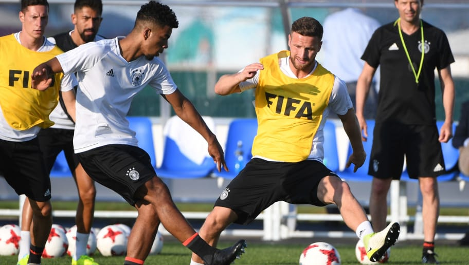 Germany's defender Benjamin Henrichs (L) and Germany's defender Shkodran Mustafi attend a training session in Sochi on June 28, 2017 on the eve of the Russia 2017 FIFA Confederations Cup football semi-final match Germany vs Mexico. / AFP PHOTO / PATRIK STOLLARZ        (Photo credit should read PATRIK STOLLARZ/AFP/Getty Images)