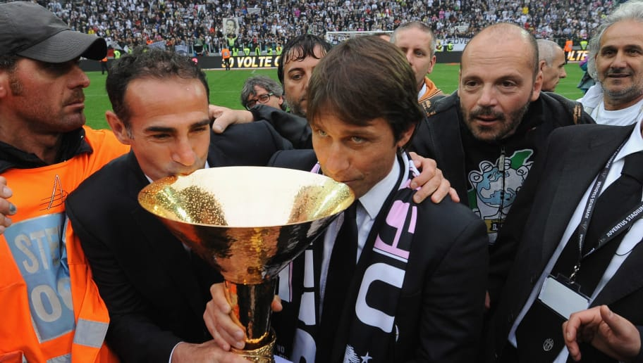 TURIN, ITALY - MAY 13:  Juventus FC head coach Antonio Conte (R) and second coach Angelo Alessio celebrate with the Serie A trophy after the Serie A match between Juventus FC and Atalanta BC at Juventus Stadium on May 13, 2012 in Turin, Italy.  (Photo by Valerio Pennicino/Getty Images)