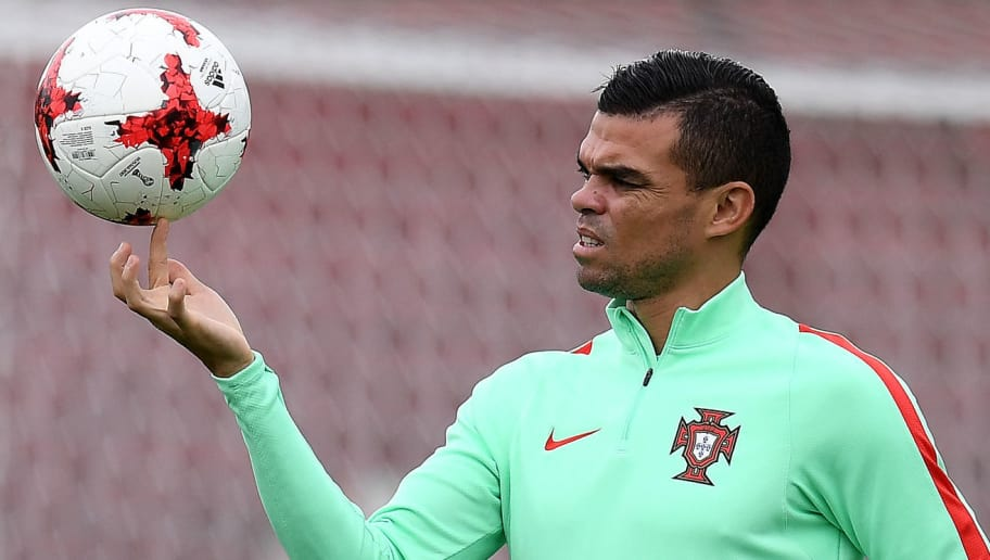 Portugal's defender Pepe eyes the ball during a training session in Kazan, Russia, on June 27, 2017 on the eve of the Russia 2017 FIFA Confederations Cup football semi-final match Portugal vs Chile. / AFP PHOTO / FRANCK FIFE        (Photo credit should read FRANCK FIFE/AFP/Getty Images)