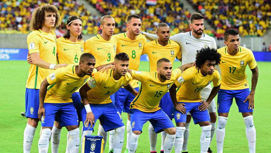 Players of Brazil pose for pictures before the start of their Russia 2018 FIFA World Cup South American Qualifiers' football match against Uruguay, in Recife, northeastern Brazil, on March 25, 2016. (L-R, back row) David Luiz, Fillipe Luis, Miranda, Renato Augusto, Fernandinho and Alisson, and (L-R, front row) Douglas Costa, Neymar, Daniel Alves, Willian and Luiz Gustavo.   AFP PHOTO / CHRISTOPHE SIMON / AFP / CHRISTOPHE SIMON        (Photo credit should read CHRISTOPHE SIMON/AFP/Getty Images)
