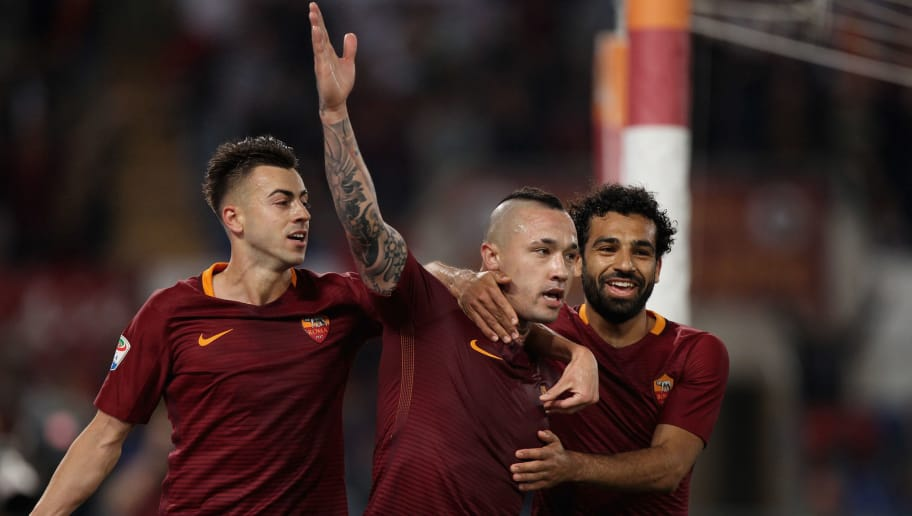 ROME, ITALY - MAY 14:  Radja Nainggolan with his teammate Stefan El Shaarawy and Mohamed Salah of AS Roma celebrates after scoring the team's third goal during the Serie A match between AS Roma and Juventus FC at Stadio Olimpico on May 14, 2017 in Rome, Italy.  (Photo by Paolo Bruno/Getty Images )