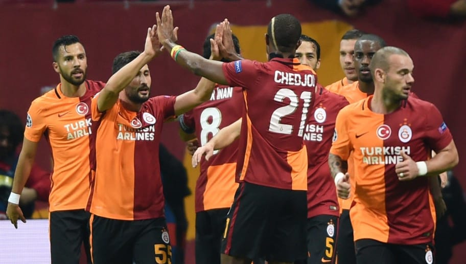 Galatasaray players celebrate after Galatasaray's German forward Lukas Podolski scored the second goal during the UEFA Champions League football match between Galatasaray AS and SL Benfica at the Ali Sami Yen Spor Kompleks stadium in Istanbul on October 21, 2015. AFP PHOTO / BULENT KILIC        (Photo credit should read BULENT KILIC/AFP/Getty Images)