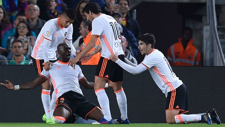 Valencia's Brazilian defender Eleaquim Mangala (L) celebrates with teammates after scoring a goal during the Spanish league football match FC Barcelona vs Valencia CF at the Camp Nou stadium in Barcelona on March 19, 2017. / AFP PHOTO / LLUIS GENE        (Photo credit should read LLUIS GENE/AFP/Getty Images)