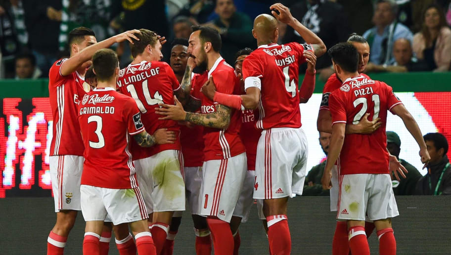 Benfica's Swedish defender Victor Lindelof (3L) celebrates a goal with teammates during the Portuguese league football match Sporting CP vs SL Benfica at the Jose Alvalade stadium in Lisbon on April 22, 2017. / AFP PHOTO / PATRICIA DE MELO MOREIRA        (Photo credit should read PATRICIA DE MELO MOREIRA/AFP/Getty Images)