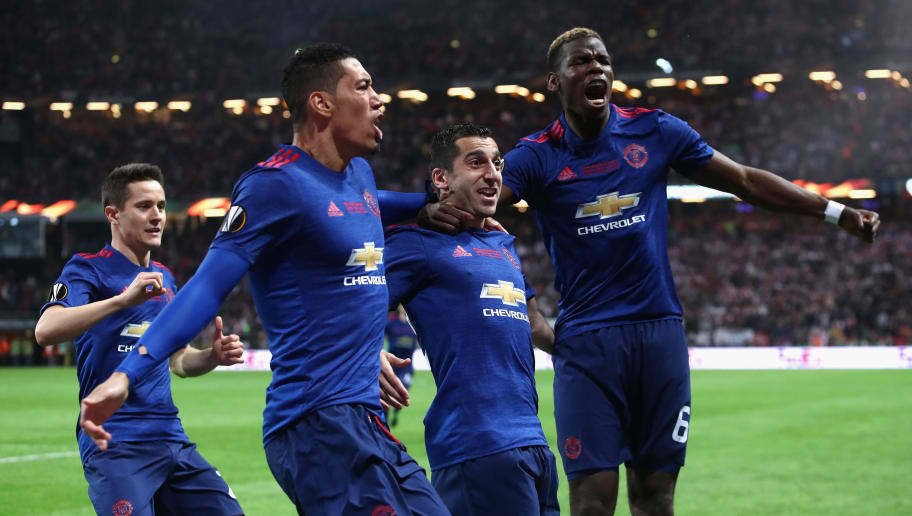 STOCKHOLM, SWEDEN - MAY 24: Henrikh Mkhitaryan of Manchester United celebrates scoring his sides second goal with Chris Smalling of Manchester United and Paul Pogba of Manchester United during the UEFA Europa League Final between Ajax and Manchester United at Friends Arena on May 24, 2017 in Stockholm, Sweden.  (Photo by Julian Finney/Getty Images)