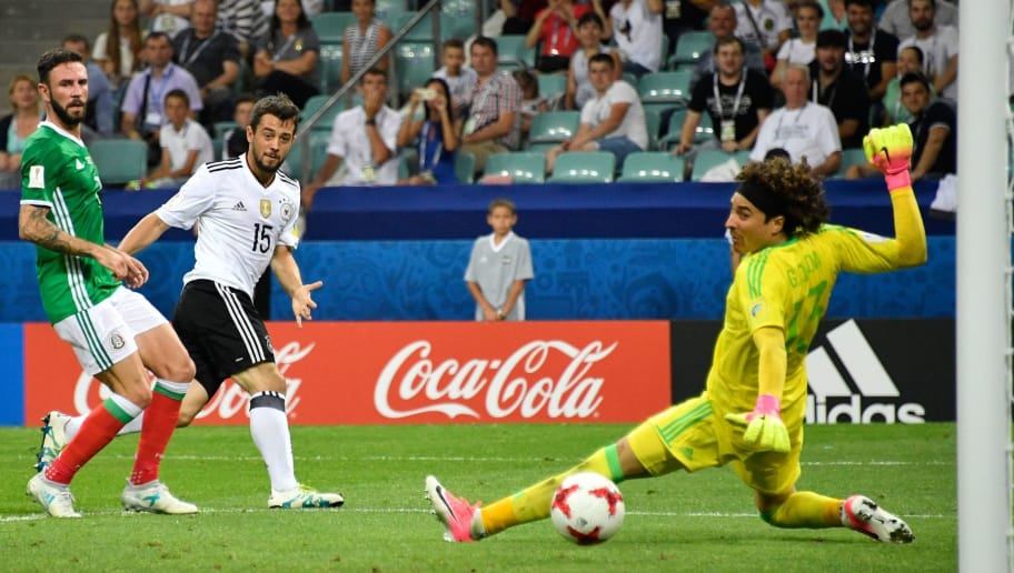 Germany's midfielder Amin Younes (2L) scores during the 2017 Confederations Cup semi-final football match between Germany and Mexico at the Fisht Stadium in Sochi on June 29, 2017. / AFP PHOTO / Alexander NEMENOV        (Photo credit should read ALEXANDER NEMENOV/AFP/Getty Images)