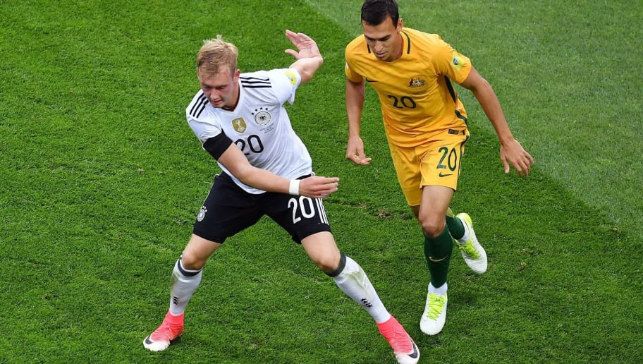 Germany's midfielder Julian Brandt (L) vies for the ball against Australia's defender Trent Sainsbury during the 2017 Confederations Cup group B football match between Australia and Germany at the Fisht Stadium in Sochi on June 19, 2017. / AFP PHOTO / Yuri CORTEZ        (Photo credit should read YURI CORTEZ/AFP/Getty Images)