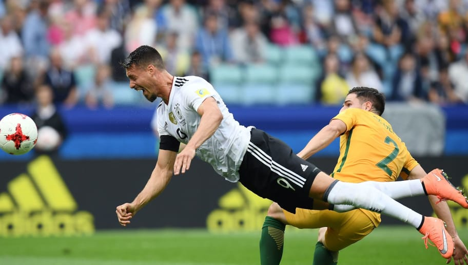 TOPSHOT - Germany's forward Sandro Wagner (L) heads the ball past Australia's defender Milos Degenek during the 2017 Confederations Cup group B football match between Australia and Germany at the Fisht Stadium in Sochi on June 19, 2017. / AFP PHOTO / FRANCK FIFE        (Photo credit should read FRANCK FIFE/AFP/Getty Images)