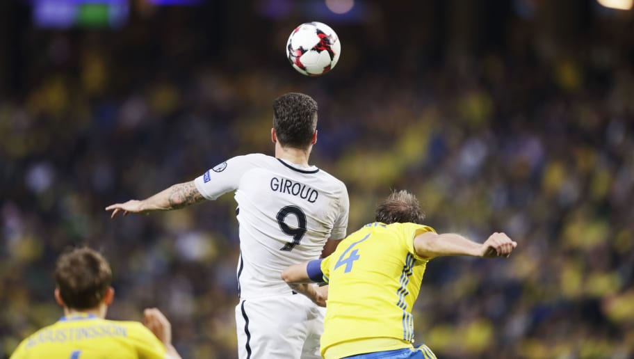 SOLNA, SWEDEN - JUNE 09: Olivier Giroud of France and Andreas Granqvist of Sweden competes for the ball during the FIFA 2018 World Cup Qualifier between Sweden and France at Friends Arena on June 9, 2017 in Solna, Sweden. (Photo by Nils Petter Nilsson/Ombrello/Getty Images)