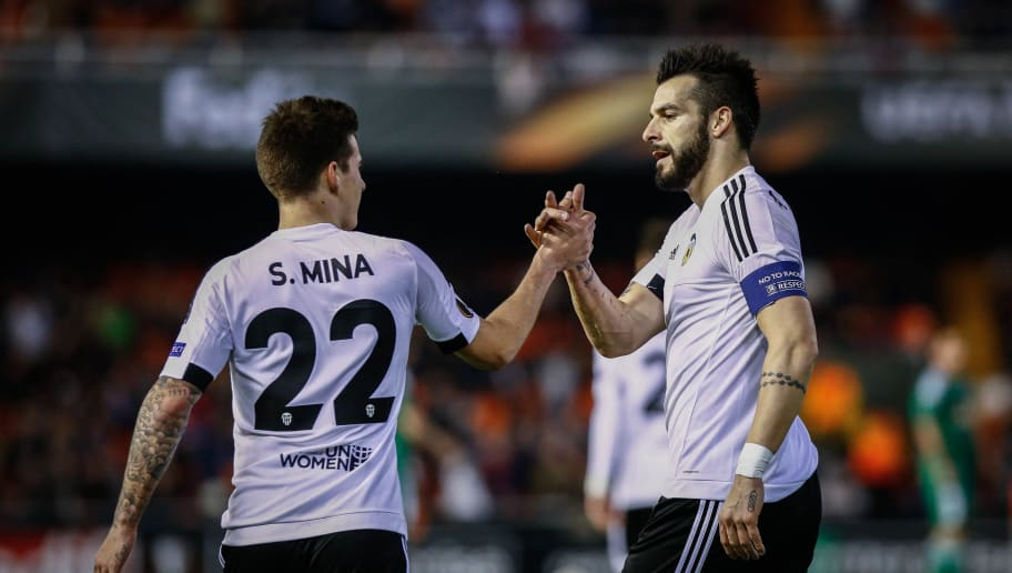 Valencia's forward Alvaro Negredo (R) celebrates a goal with teammate Valencia's forward Santi Mina during the UEFA Europa League Round of 32 first leg football match Valencia CF vs SK Rapid Wien at the Mestalla stadium in Valencia on February 18, 2016. / AFP / BIEL ALINO        (Photo credit should read BIEL ALINO/AFP/Getty Images)
