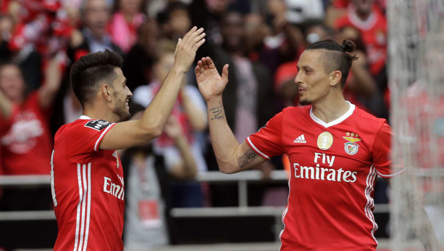 Benfica's forward Pizzi (L) celebrates his goal with Serbian midfielder Ljubomir Fejsa during the Portuguese league football match SL Benfica vs Vitoria Guimaraes SC at the Luz stadium in Lisbon on May 13, 2017. / AFP PHOTO / JOSE MANUEL RIBEIRO        (Photo credit should read JOSE MANUEL RIBEIRO/AFP/Getty Images)
