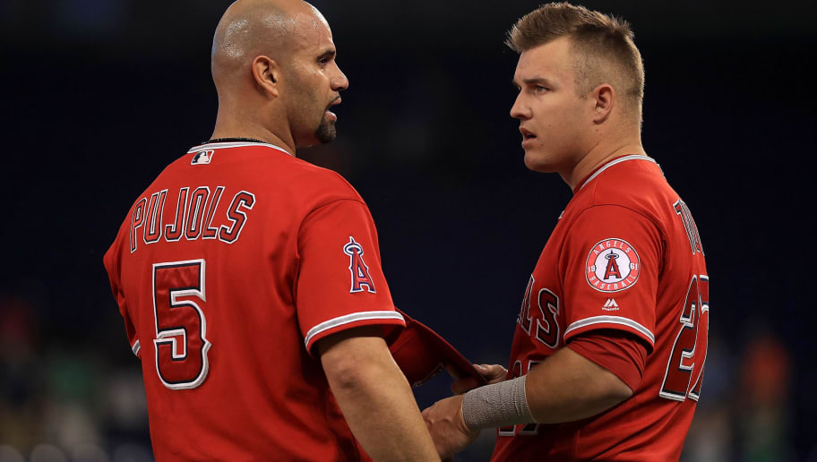 MIAMI, FL - MAY 26:  Albert Pujols #5 and Mike Trout #27 of the Los Angeles Angels talk during a game against the Miami Marlins at Marlins Park on May 26, 2017 in Miami, Florida.  (Photo by Mike Ehrmann/Getty Images)