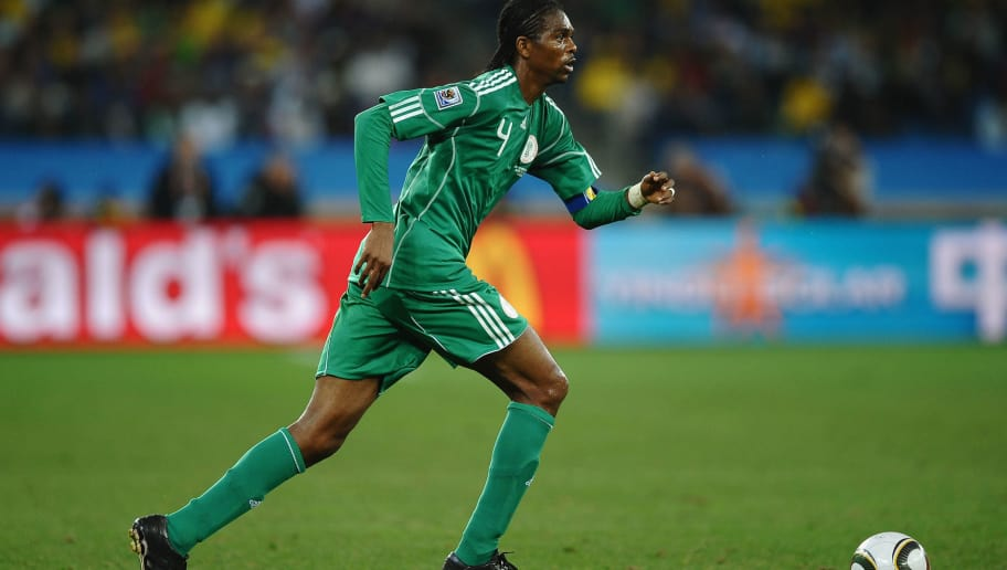 DURBAN, SOUTH AFRICA - JUNE 22:  Nwankwo Kanu of Nigeria runs with the ball during the 2010 FIFA World Cup South Africa Group B match between Nigeria and South Korea at Durban Stadium on June 22, 2010 in Durban, South Africa.  (Photo by Laurence Griffiths/Getty Images)