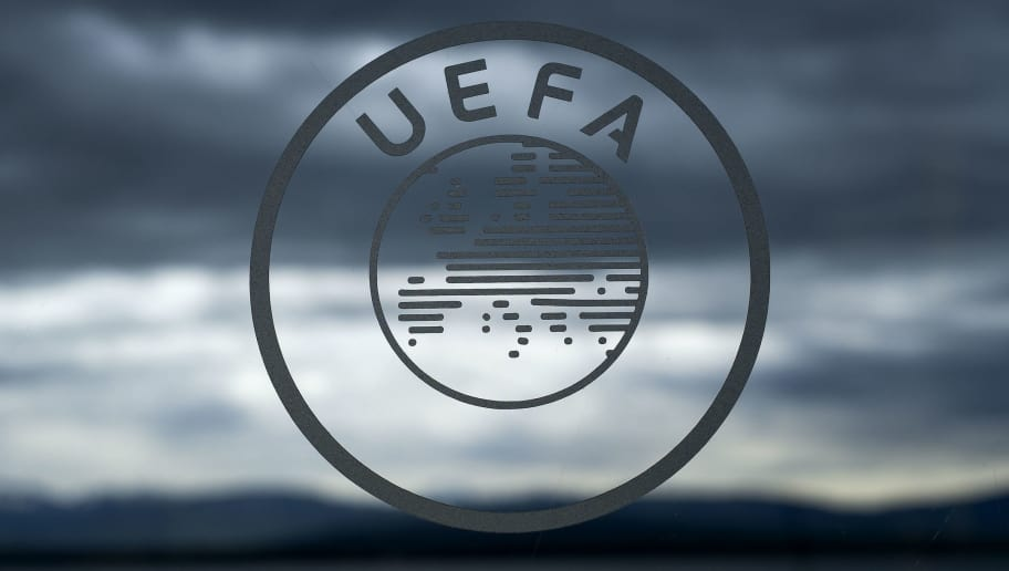 The logo of the UEFA is seen under dark clouds the European fooball governing body's headquarters in Nyon on April 15, 2016. / AFP / FABRICE COFFRINI        (Photo credit should read FABRICE COFFRINI/AFP/Getty Images)