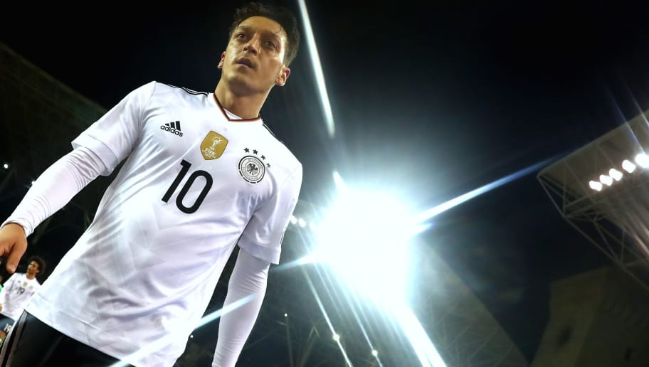 BAKU, AZERBAIJAN - MARCH 26:  (EDITORS NOTE: Star effect filter used to create this picture)  Mesut Oezil of Germany looks on after the FIFA 2018 World Cup Qualifing Group C between Azerbaijan and Germany at Tofiq Bahramov Stadium on March 26, 2017 in Baku, .  (Photo by Alexander Hassenstein/Bongarts/Getty Images)