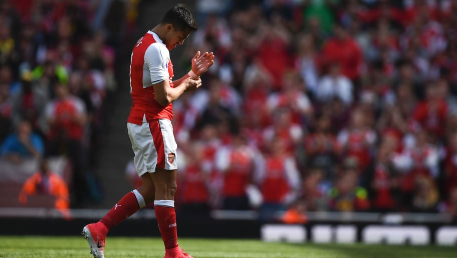 Arsenal's Chilean striker Alexis Sanchez leaves the pitch during the English Premier League football match between Arsenal and Everton at the Emirates Stadium in London on May 21, 2017.  / AFP PHOTO / Justin TALLIS / RESTRICTED TO EDITORIAL USE. No use with unauthorized audio, video, data, fixture lists, club/league logos or 'live' services. Online in-match use limited to 75 images, no video emulation. No use in betting, games or single club/league/player publications.  /         (Photo credit should read JUSTIN TALLIS/AFP/Getty Images)