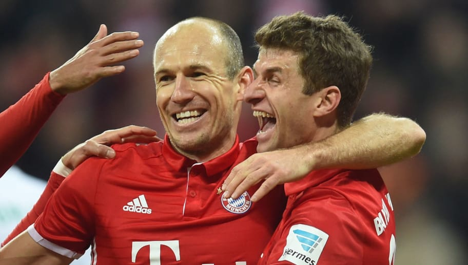 (L-R) Bayern Munich's Spanish midfielder Thiago Alcantara, Bayern Munich's Dutch midfielder Arjen Robben and Bayern Munich's striker Thomas Mueller celebrate after the fourth goal for Munich during the German first division Bundesliga football match between FC Bayern Munich and Wolfsburg in Munich, southern Germany, on December 10, 2016.  / AFP / CHRISTOF STACHE / RESTRICTIONS: DURING MATCH TIME: DFL RULES TO LIMIT THE ONLINE USAGE TO 15 PICTURES PER MATCH AND FORBID IMAGE SEQUENCES TO SIMULATE VIDEO. == RESTRICTED TO EDITORIAL USE == FOR FURTHER QUERIES PLEASE CONTACT DFL DIRECTLY AT + 49 69 650050         (Photo credit should read CHRISTOF STACHE/AFP/Getty Images)