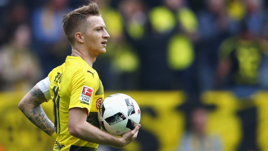 DORTMUND, GERMANY - MAY 20:  Marco Reus of Borussia Dortmund celebrates scoring his teams third goal of the game during the Bundesliga match between Borussia Dortmund and Werder Bremen at Signal Iduna Park on May 20, 2017 in Dortmund, Germany.  (Photo by Dean Mouhtaropoulos/Bongarts/Getty Images)