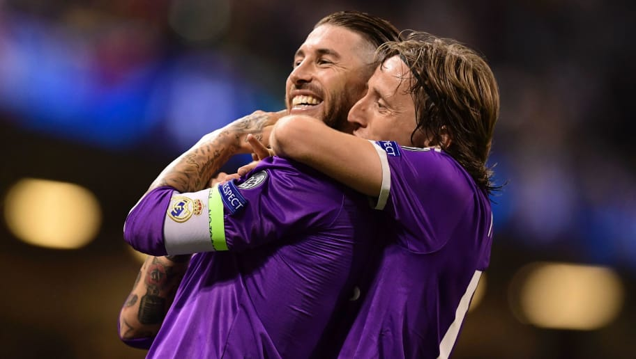TOPSHOT - Real Madrid's Spanish defender Sergio Ramos (L) and Real Madrid's Croatian midfielder Luka Modric celebrate after Real score their fourth goal during the UEFA Champions League final football match between Juventus and Real Madrid at The Principality Stadium in Cardiff, south Wales, on June 3, 2017. Real Madrid beat Juventus 4-1 to win Champions League. / AFP PHOTO / JAVIER SORIANO        (Photo credit should read JAVIER SORIANO/AFP/Getty Images)
