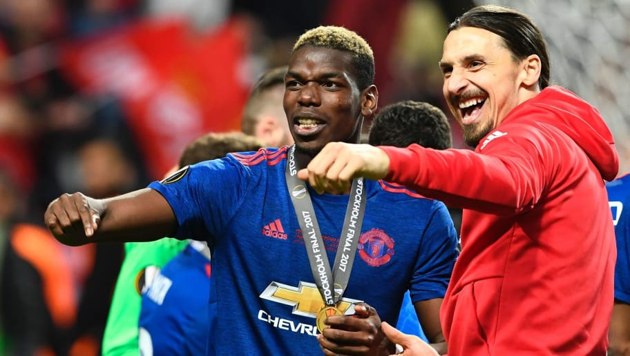 Manchester United's French midfielder Paul Pogba celebrates with his medal and Manchester United's Swedish striker Zlatan Ibrahimovic (R) after the UEFA Europa League final football match Ajax Amsterdam v Manchester United on May 24, 2017 at the Friends Arena in Solna outside Stockholm. / AFP PHOTO / Jonathan NACKSTRAND        (Photo credit should read JONATHAN NACKSTRAND/AFP/Getty Images)