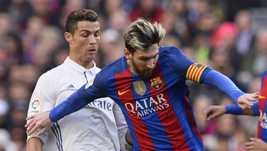 Barcelona's Argentinian forward Lionel Messi (C) vies with Real Madrid's Portuguese forward Cristiano Ronaldo during the Spanish league football match FC Barcelona vs Real Madrid CF at the Camp Nou stadium in Barcelona on December 3, 2016. / AFP / JOSEP LAGO        (Photo credit should read JOSEP LAGO/AFP/Getty Images)