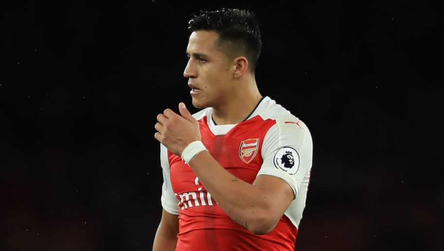 LONDON, ENGLAND - MAY 16:  Alexis Sanchez of Arsenal shows off a stud mark on his leg during the Premier League match between Arsenal and Sunderland at Emirates Stadium on May 16, 2017 in London, England.  (Photo by Richard Heathcote/Getty Images)