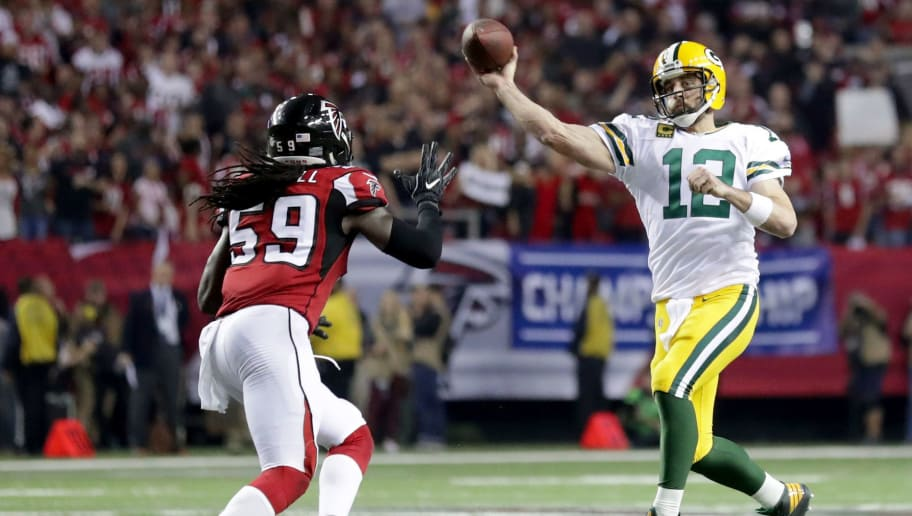 ATLANTA, GA - JANUARY 22: Aaron Rodgers #12 of the Green Bay Packers looks to pass in the second half against De'Vondre Campbell #59 of the Atlanta Falcons in the NFC Championship Game at the Georgia Dome on January 22, 2017 in Atlanta, Georgia.  (Photo by Streeter Lecka/Getty Images)