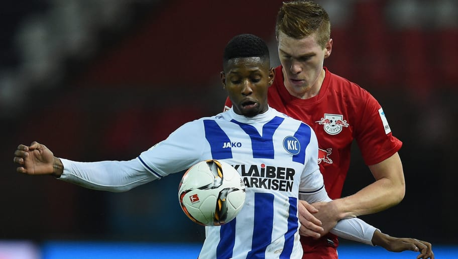 KARLSRUHE, GERMANY - NOVEMBER 30:  Barry Boubacar (L) of Karlsruhe and Marcel Halstenberg (R) of RB Leipzig compete for the ball during the Second Bundesliga match between Karlsruher SC and RB Leipzig at Wildpark Stadium on November 30, 2015 in Karlsruhe, Germany.  (Photo by Matthias Hangst/Bongarts/Getty Images)