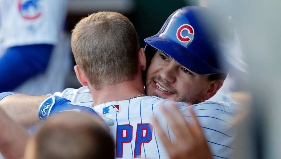 CHICAGO, IL - JULY 08: Kyle Schwarber #12 of the Chicago Cubs (R) hugs Ian Happ #8 after they hit back-to-back home runs against the Pittsburgh Pirates during the fourth inning at Wrigley Field on July 8, 2017 in Chicago, Illinois. (Photo by Jon Durr/Getty Images)