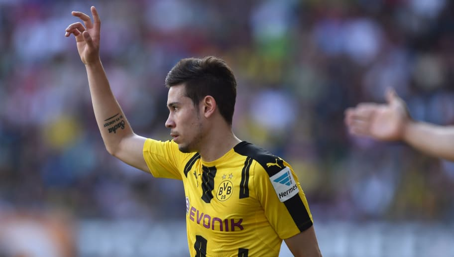 Dortmund's Portuguese defender Raphael Guerreiro gestures during the German first division Bundesliga football match between FC Augsburg and Borussia Dortmund on May 13, 2017 in Augsburg, southern Germany.  / AFP PHOTO / Christof STACHE / RESTRICTIONS: DURING MATCH TIME: DFL RULES TO LIMIT THE ONLINE USAGE TO 15 PICTURES PER MATCH AND FORBID IMAGE SEQUENCES TO SIMULATE VIDEO. == RESTRICTED TO EDITORIAL USE == FOR FURTHER QUERIES PLEASE CONTACT DFL DIRECTLY AT + 49 69 650050         (Photo credit should read CHRISTOF STACHE/AFP/Getty Images)