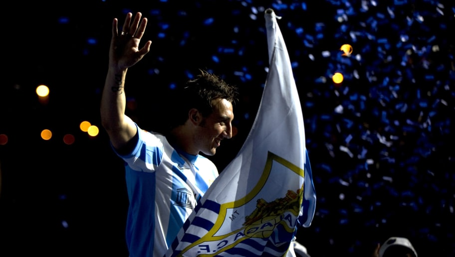 Malaga's new football player midfielder Santi Cazorla waves to supporters during his official presentation in Malaga, on August 1, 2011.  AFP PHOTO/ JORGE GUERRERO (Photo credit should read Jorge Guerrero/AFP/Getty Images)
