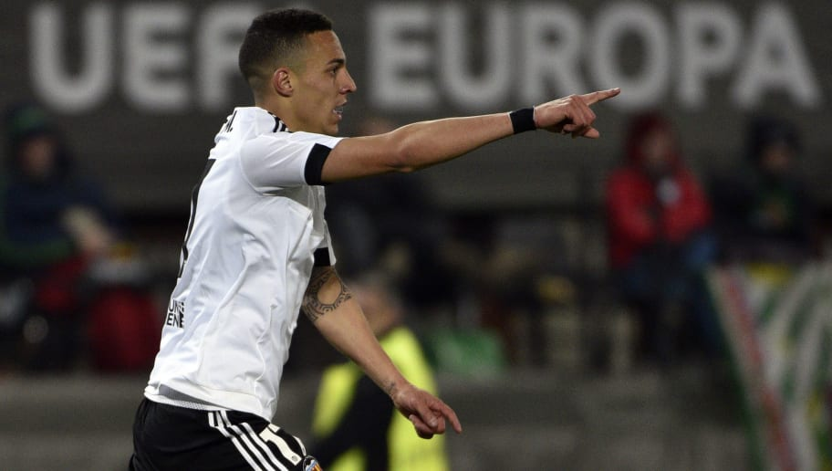 Valencia's forward Rodrigo celebrates after scoringduring the UEFA Europa League, Round of 32 match football between Rapid Wien and Valencia in Vienna, Austria on February 25, 2016.  / AFP / HANS PUNZ        (Photo credit should read HANS PUNZ/AFP/Getty Images)