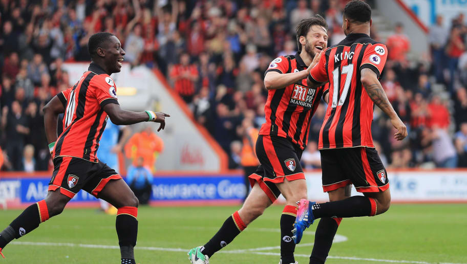 BOURNEMOUTH, ENGLAND - MAY 06: Joshua King of AFC Bournemouth celebrates Ryan Shawcross of Stoke City (not pictured) scoring a own goal for AFC Bournemouth's second goal with Harry Arter of AFC Bournemouth and Max Gradel of AFC Bournemouth during the Premier League match between AFC Bournemouth and Stoke City at the Vitality Stadium on May 6, 2017 in Bournemouth, England.  (Photo by Richard Heathcote/Getty Images)