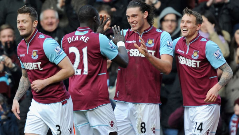 LONDON, ENGLAND - MARCH 30:  Andy Carroll of West Ham United (C) celebrates scoring his second goal and his team's third with teammates Mohamed Diame (second left) and Matthew Taylor (R)  during the Barclays Premier League match between West Ham United and West Bromwich Albion at the Boleyn Ground on March 30, 2013 in London, England.  (Photo by Steve Bardens/Getty Images)